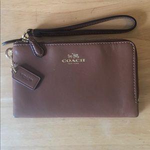 NWOT Coach Brown leather double zipper wristlet.